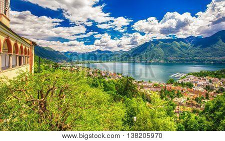 View to Locarno city lake Maggiore (Lago Maggiore) and Swiss Alps in Ticino from from Madonna del Sasso Church Switzerland.