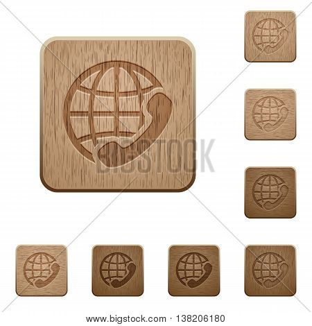Set of carved wooden International call buttons in 8 variations.