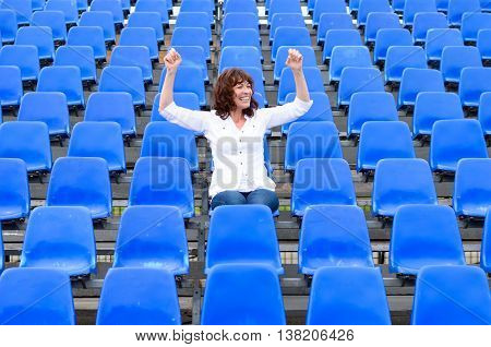 Lone Female Fan Or Spectator Sitting Cheering