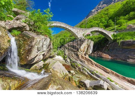 Double arch stone bridge at Ponte dei Salti with waterfall Lavertezzo Verzascatal Canton Tessin.