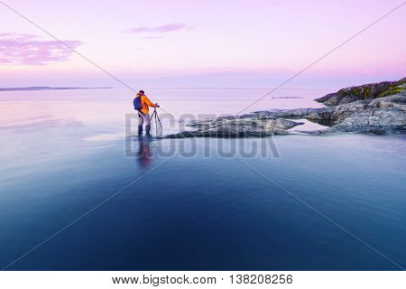 Photographer taking pictures of the island at dawn