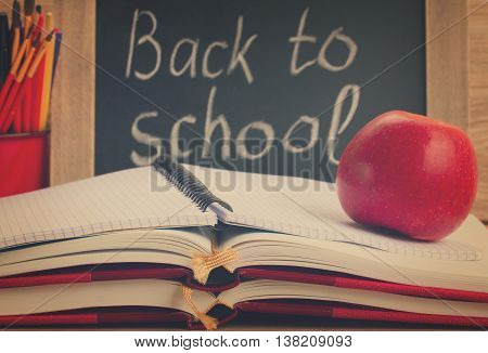 black chalk board with back to school and school supplies, retro toned
