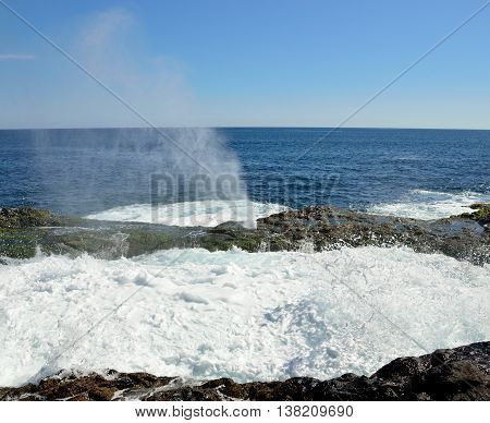 Natural pool with water in full effervescence at high tide, coast of Gran canaria, Canary islands