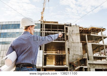 Chief Construction with drawings manages the facility
