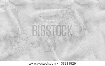 Background texture of crumpled grungy light grey paper in a close up full frame surface view