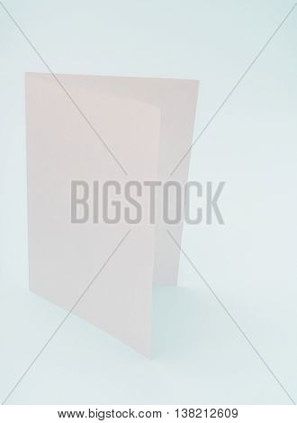 Bifold white template paper on blue background