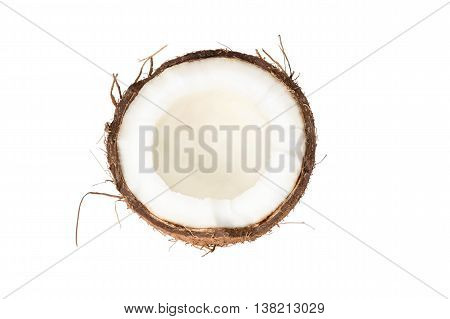 Half of ripe brown cracked coconut isolated on white background