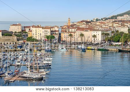 Ajaccio France - May 27 2016: View of the center of capital city of Corsica and birthplace of Napoleon Bonaparte with its marina Fishing Port water front and a part of the citadel on the left.