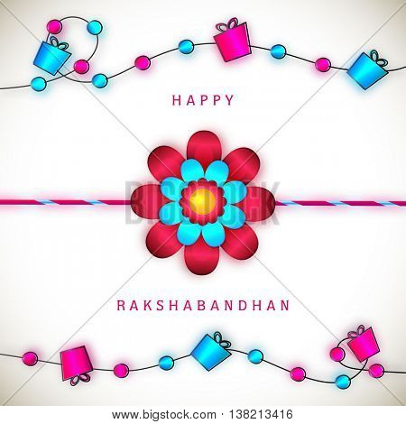 Beautiful Glowing Rakhi on gifts decorated stylish background, Elegant Greeting Card design for Indian Festival of Brothers and Sisters, Happy Raksha Bandhan celebration.
