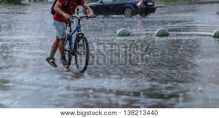 bicycle rider in the rain at city