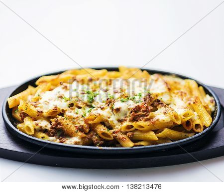 baked penne pasta bolognaise bolognese beef sauce with cheese on white background