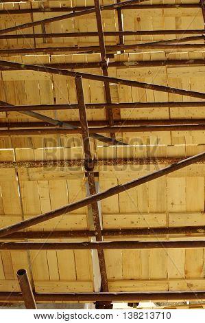 Scaffolding equipment buildings wooden floorboards industry theme.