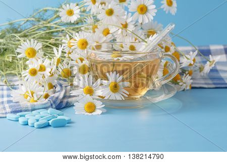 Herbal Tea In A Glass Cup, Bouquet Chamomiles. Pills And Thermometer