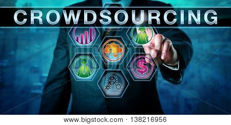 Male entrepreneur is touching CROWDSOURCING on an interactive control screen. Concept for the process of outsourcing business needs to an online crowd of contributors and part-time workers.