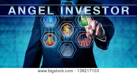 Male entrepreneur is pushing ANGEL INVESTOR on an interactive touch screen. Start up finance concept for business angel informal investor angel funder or seed investor especially the tech sector.