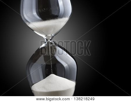 Close up hourglass on a black background