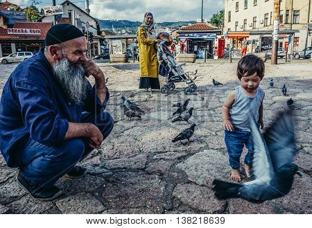 Sarajevo Bosnia and Herzegovina - August 23 2015. Bosnian family at old bazaar and the historical and cultural center of the Sarajevo called Bascarsija