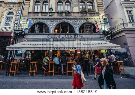 Sarajevo Bosnia and Herzegovina - August 23 2015. People walks in front of restaurant at Zelenih Beretki Street