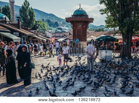 Sarajevo Bosnia and Herzegovina - August 23 2015. Tourists and local residents walks around Sebilj fountain located at main square of Bascarsija area in Sarajevo