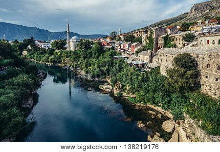 Mostar Bosnia and Herzegovina - August 25 2015. View from Old Bridge over Neretva river foremost landmark of Old Town of Mostar