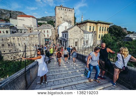 Mostar Bosnia and Herzegovina - August 25 2015. People walks on Old Bridge foremost landmark of Old Town of Mostar