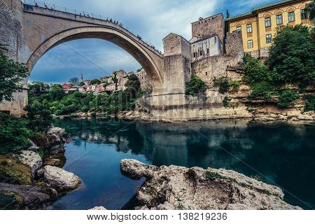 Mostar Bosnia and Herzegovina - August 25 2015. Old Bridge over Neretva river foremost landmark of Old Town of Mostar