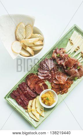 spanish serrano ham chorizo sausage and cheese tapas snack platter