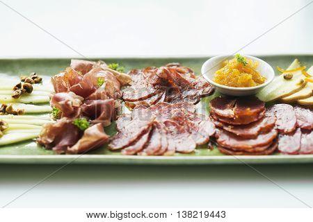 spanish serrano ham chorizo sausage and cheese tapas traditional snack platter