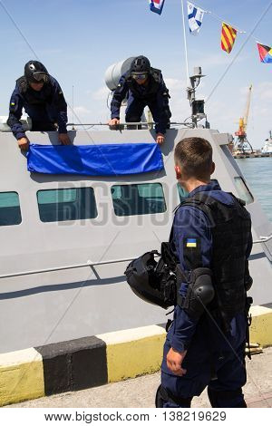 Odesa, Ukraine - July 03, 2016: Military sailors near new warship 'Akerman'. Celebration of Ukrainian NAVY forces day