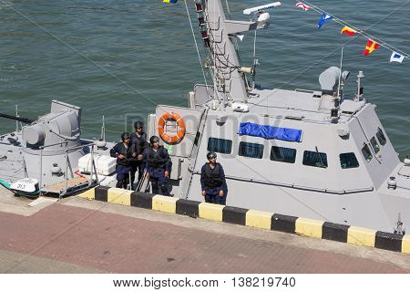 Odesa, Ukraine - July 03, 2016: sailors on the background of the new armored boats during the ship naming ceremony.