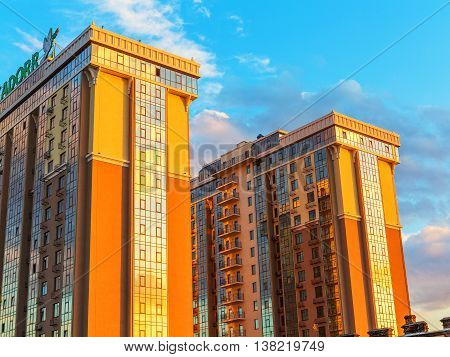 Odessa, Ukraine July 6, 2016: The Old Roofs On A Background Of A Modern High-rise Building, The Suns