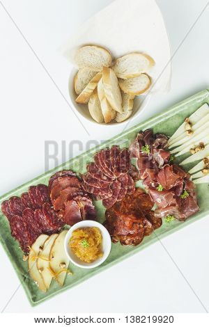 spanish serrano ham chorizo sausage smoked meats cheese tapas sharing platter set with bread