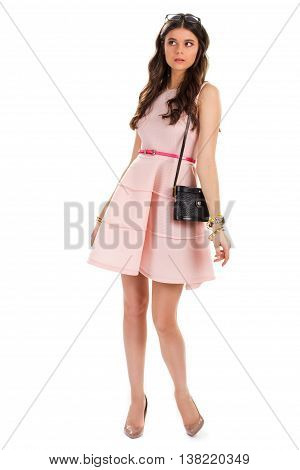 Girl wearing dress and shoes. Heels and short salmon dress. Lady with disappointed face expression. Can't believe what I see.