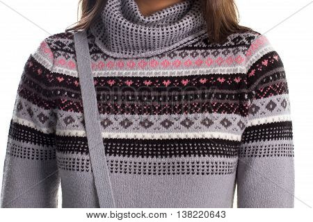 Woman in a sweater. Pullover with black print. Woolen garment on white background. Comfort and warmth.