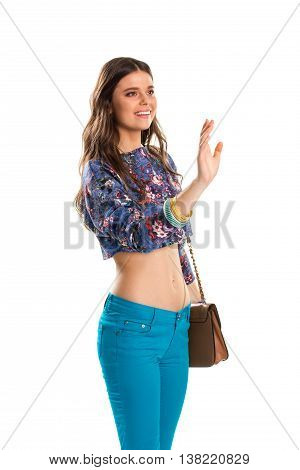 Woman in crop top smiles. Lady waves her hand. Good look and manners. Beautiful clothes of bright colors.