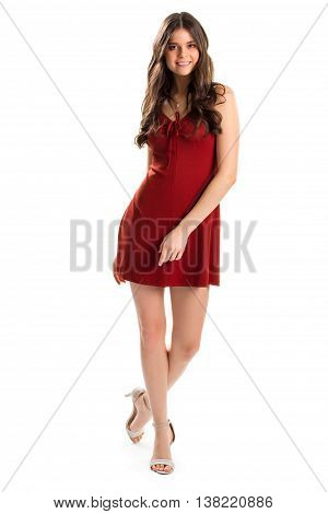 Woman in red dress smiles. Keyhole dress and heels. Young model in feminine clothing. Simple evening dress with shoes.