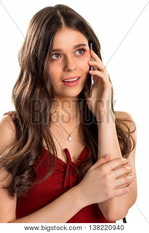 Girl talking on the phone. Red keyhole dress and necklace. Less words more meaning. Interest and anticipation.