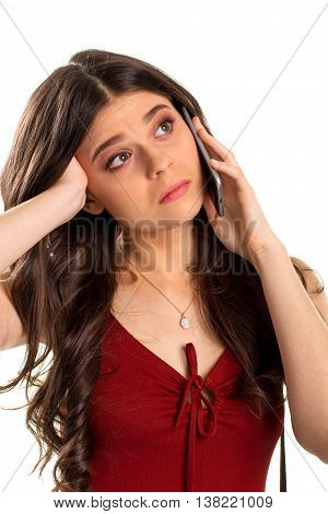 Bored woman holds cell phone. Small pendant on girl's neck. Your offer doesn't interest me. It's a waste of time.