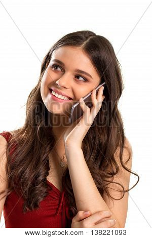 Girl with phone smiles. Happy lady on blank background. Charge of positive mood. Sharing joy with loved ones.