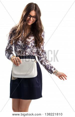 Lady in floral shirt smiling. Shirt with print and skirt. Model in glasses is posing. Ease and style.