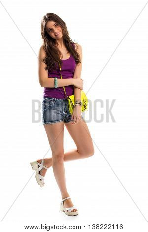 Girl in purple top smiling. White sandals and lime bag. Comfortable clothes of natural materials. Lady in good mood.