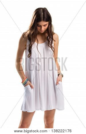 Woman in sarafan looks down. Set of colorful bracelets. Sad model on white background. Moment of sorrow.