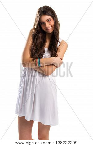 Lady in sundress is smiling. Short white sarafan. Cute model with crossed arms. Million dollar smile.