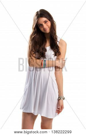 Woman in white sundress smiling. Lady wears colorful bracelets. Beautiful model with long hair. What a charming look.