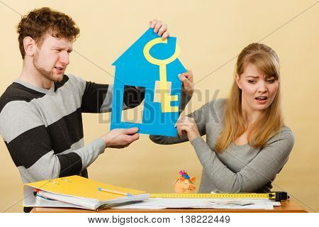 Advantages and disadvantages of living together. Young couple marriage arguing of new house home flat apartment place to live.