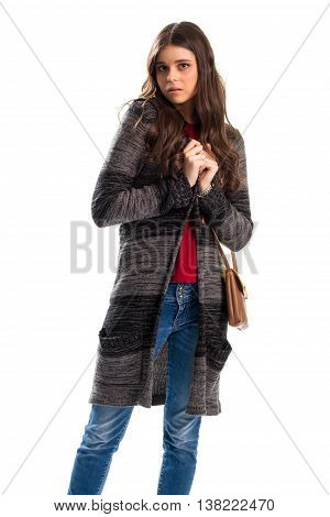 Girl in sweater coat. Scared lady on white background. Tender and vulnerable. Model in warm clothes.