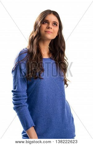 Girl in sweatshirt looks up. Woman in plain blue sweater. Hopes and dreams. Find purpose in your life.