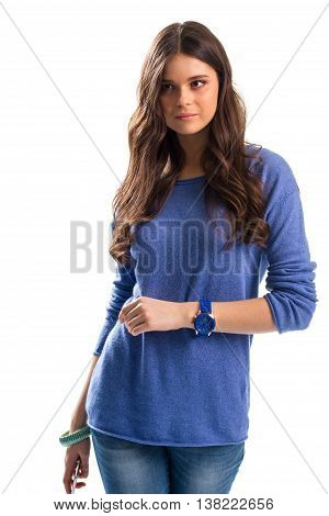 Lady in blue sweater. Denim pants and blue watch. Comfortable wear for spring. Reliable sports watch.