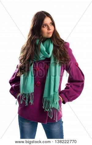 Girl in purple coat. Scarf with fringe and jeans. New fleece outerwear. Warm autumn outfit with scarf.