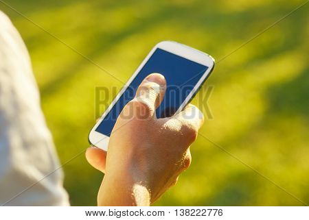 Man With Smartphone In The Hand Using Social Networks